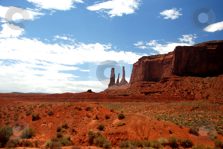 Three sisters in the desert stock photo, The three sisters of the famous monument valley views from a different location by Alberto Regnani