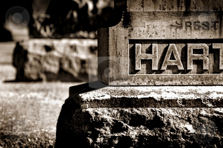 Rest Hart BW stock photo, Old gray gravestone in cemetery with partial writing. by Henrik Lehnerer