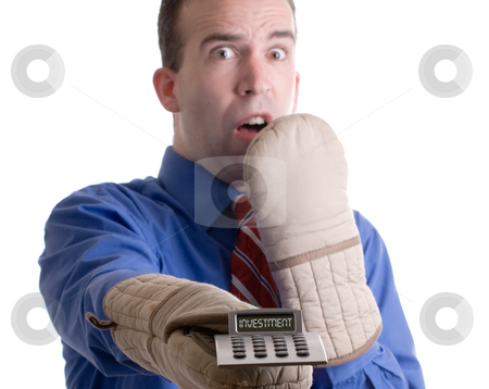Nervous Banker stock photo, Concept image of a nervous banker holding onto his investment with oven mitts, isolated against a white background by Richard Nelson