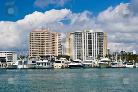 Luxury condo or resort on water stock photo, Luxury condos with marina by Steve Carroll