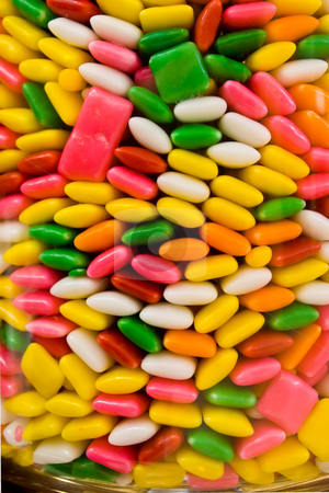 Candy in Jar stock photo, Candy; bits; gum; pieces; jar; bright; colors; brightly; shapes; texture; background; colored; chicklets; by Steve Carroll