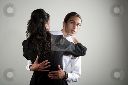 Mixed race professional man embracing Hispanic woman stock photo, Handsome mixed race man embracing pretty Hispanic coworker by Scott Griessel