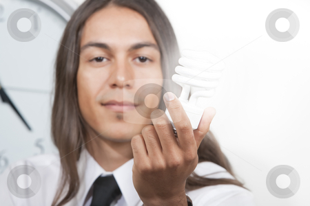 Man with glowing energy efficient lightbulb stock photo, Handsome young man holding glowing energy efficient lightbulb by Scott Griessel