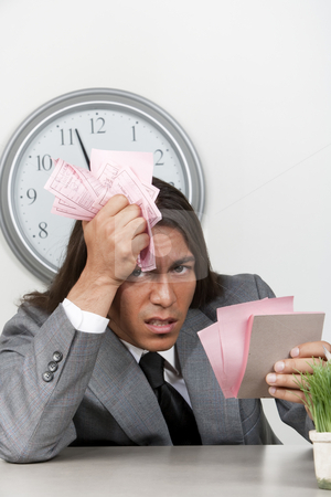 Businessman with too much to do stock photo, Mixed race businessman with many to do notes by Scott Griessel