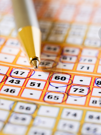 Bingo ticket stock photo, Closeup of the lottery ticket with a pencil on it. by Sinisa Botas