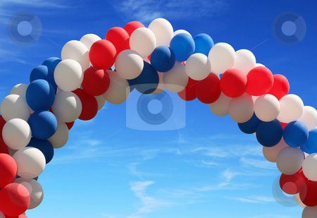 Balloon arch 3 stock photo, Red white and blue patriotic balloons on pretty blue sky by Stacy Barnett