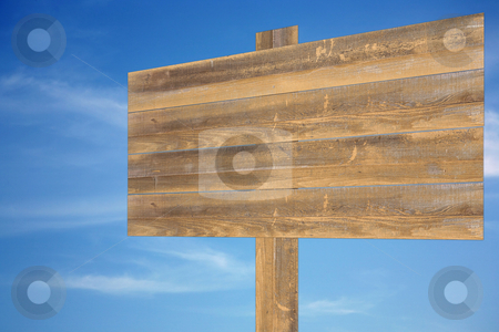 Cloudy sky with wooden sign stock photo, Beautiful blue heavenly and soft cloudy sky with blank wooden sign by Stacy Barnett