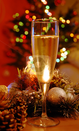 New year champagne stock photo, Glass of champagne over new year decoration by Julija Sapic