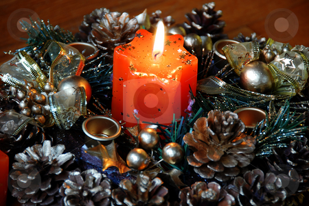 Burning christmas candle stock photo, Burning orange star shape candle over new year decoration by Julija Sapic