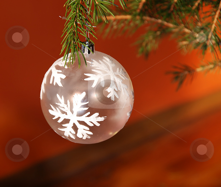 Christmas ball stock photo, Christmas white ball on green new year tree over orange by Julija Sapic