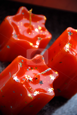 Red candles stock photo, Three orange unlit star shape candles closeup by Julija Sapic