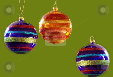 Christmas balls stock photo, Three christmas balls decorations isolated over green by Julija Sapic