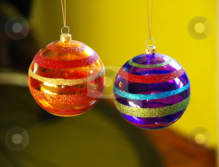 Christmas balls stock photo, Two purple and orange christmas balls decorations closeup by Julija Sapic