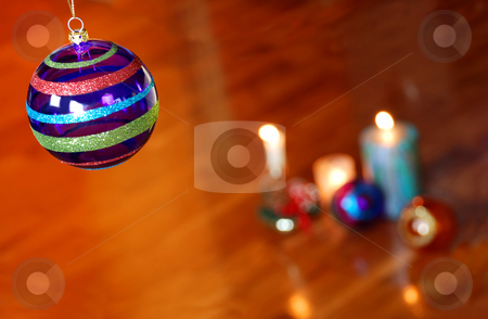 Christmas collage on parquet stock photo, Christmas decorative glass ball hanging over orange parquet indoor by Julija Sapic