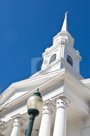 Church Steeple stock photo, White church steeple against a dark blue sky by Steve Carroll
