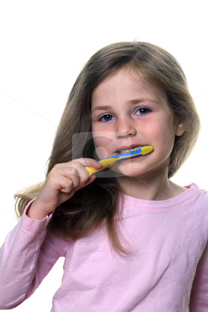 Child brushing teeth stock photo, Cute little girl using a toothbrush to brush her baby teeth by Anita Peppers