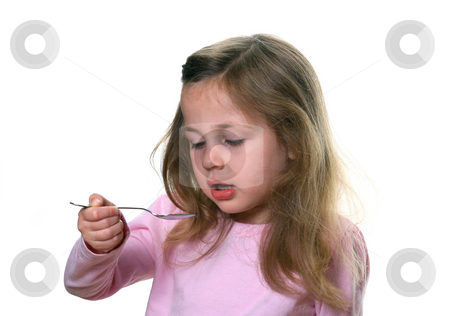 Child Taking Medicine stock photo, Little girl holding a spoon about to take liquid medication by Anita Peppers