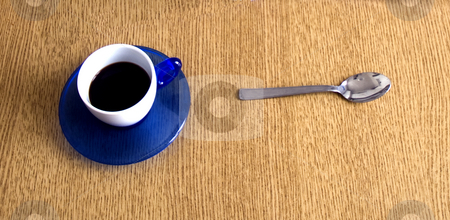 Coffee stock photo, A cup of coffe and a metal spoon on wooden table by Fabio Alcini
