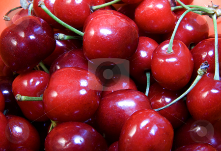 Cherries stock photo, Close up of a bunch of red cherries by Fabio Alcini