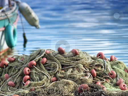 Fishing net stock photo, Fishing Nets on the waterfront after fishing day. by Sinisa Botas