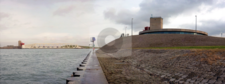 Caland barrage stock photo, Panoramic image of the civil engineering marvel of the Caland barrage in the Europoort, the Netherlands just before sunset by Corepics VOF
