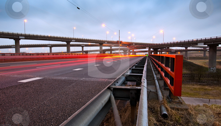 Highway Overpass stock photo, A highway overpass with busy traffic at night. Various roads intertwining with each other by Corepics VOF