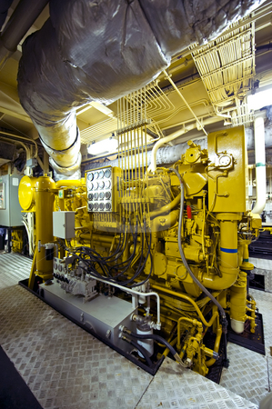 Tugboat diesel engine stock photo, The huge and powerful disel engine of a tugboat by Corepics VOF