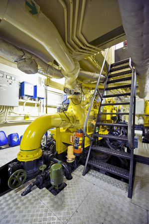 Tugboat's engine room stock photo, The engine room of a tugboat with its huge diesel engines by Corepics VOF