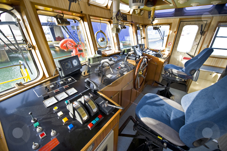 The wheelhouse of a fire boat stock photo, The wheelhouse of a fireboat with various navigational equipment by Corepics VOF
