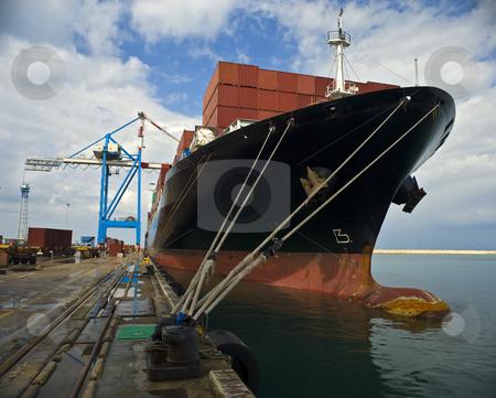 Cargo ship stock photo, Cargo ship at dock by Noam Armonn
