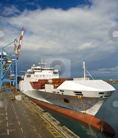 Cargo ship stock photo, Cargo ship at dock by Noam Armonn