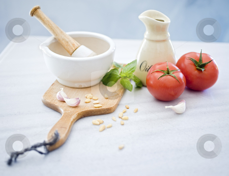 Pestle mortar fresh herbs stock photo, Pestle mortar, bazil, tomatoes, garlic, olive oil and pine nuts by Noam Armonn