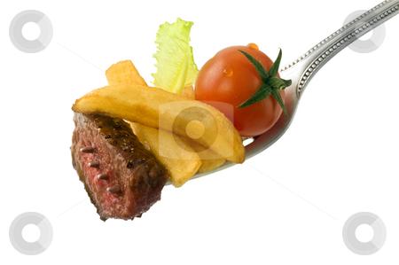 Steak on fork stock photo, Steak, franch fries, cherry tomato and lettuce on fork isolated on white by Noam Armonn