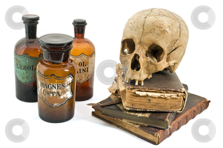 The alchimist still life stock photo, Skull, old books, old drug bottles isolated on white by Noam Armonn