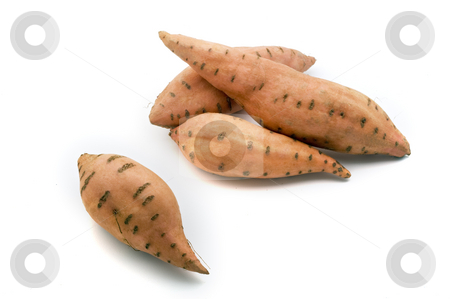 Sweet potatos stock photo, Four sweet potatos isolated on white by Noam Armonn