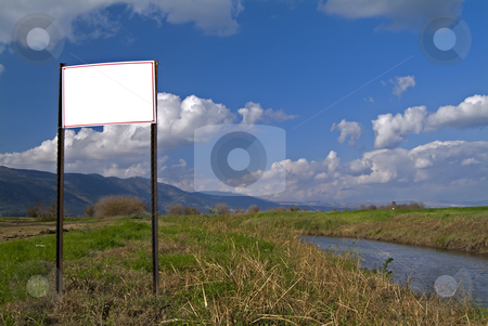 Empty sign in the wild stock photo, Empty sign with red frame in the wild with cloudscape background in north Israel by Noam Armonn