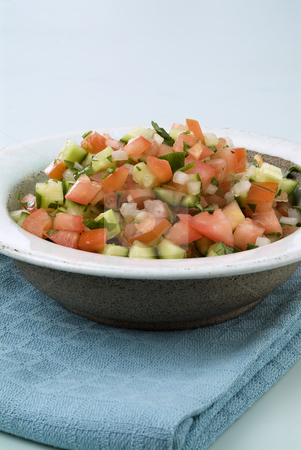 Israeli salad stock photo, Israeli arabic salad made of tomatoes, cucumbers, parsly and onion by Noam Armonn