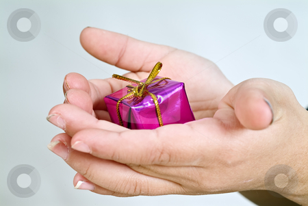 Small gift stock photo, Small gift in child hands by Noam Armonn