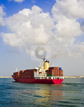 Cargo ship stock photo, Fully loaded cargo ship leaving the port by Noam Armonn