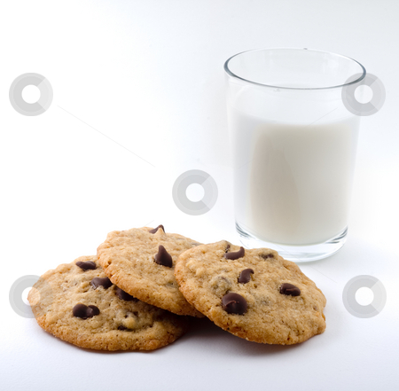Chocolate chip cookies and milk  stock photo, Chocolate chip cookies and milk  isolated on white by Noam Armonn
