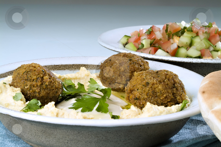 Hummus falafel and arabic salad stock photo, Falafel balls with hummus, arabic salad, pita and a tahini sauce. by Noam Armonn