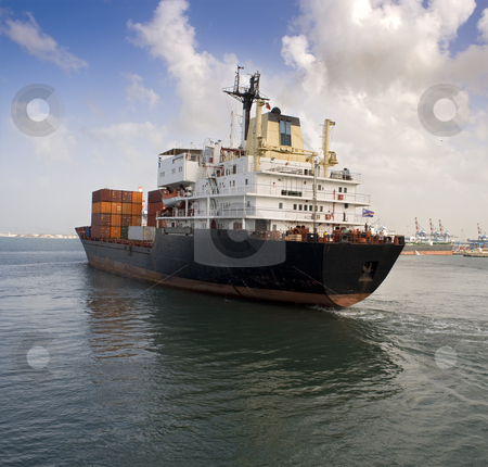 Cargo ship stock photo, Cargo ship leaving the harbor by Noam Armonn
