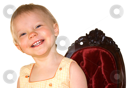 One Year Old Girl Smiling in Princess Chair stock photo, This one year old toddler girl is smiling in a burgundy colored princess type chair on a white background. by Valerie Garner