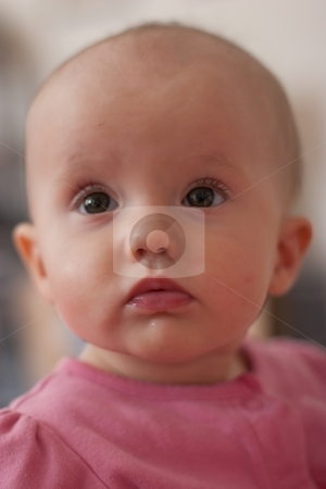 Fun time stock photo, Cute little caucasian baby girl sitting and playing. by Mariusz Jurgielewicz