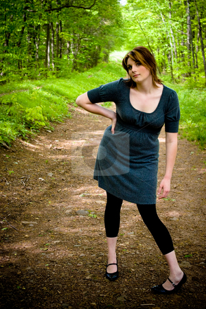 Path Through the Woods stock photo, A young woman posing on a wooded path. by Todd Arena