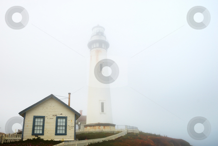 Pigeon Point Lighthouse In Dense Fog stock photo, Pigeon Point Lighthouse near Pescadero, California on a foggy day. by Denis Radovanovic