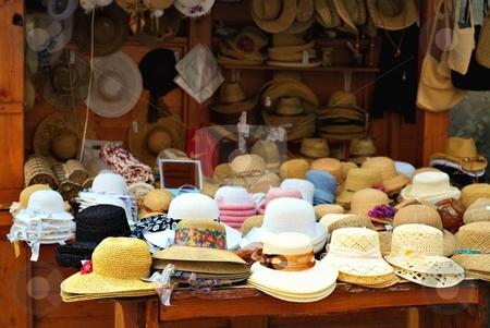 Straw hats stock photo, Straw hats on a market in a small city by Juraj Kovacik