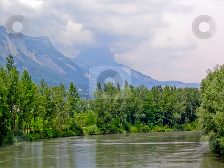 River, hills and trees stock photo, River, hills and trees outside of Grenoble by Jaime Pharr
