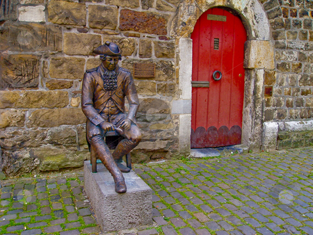 Statue and red door stock photo, Statue, stone wall and red door in Aachen by Jaime Pharr
