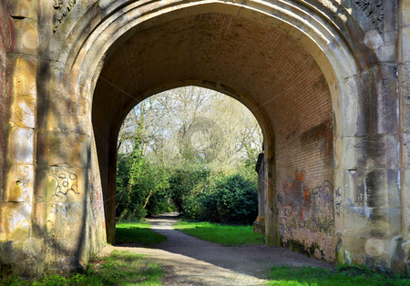 Arched Graffiti Walkway stock photo, Walkway under an arch with graffiti on walls by Robert Ford